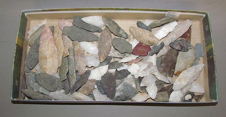 Box of about 103 stone arrow and spear points