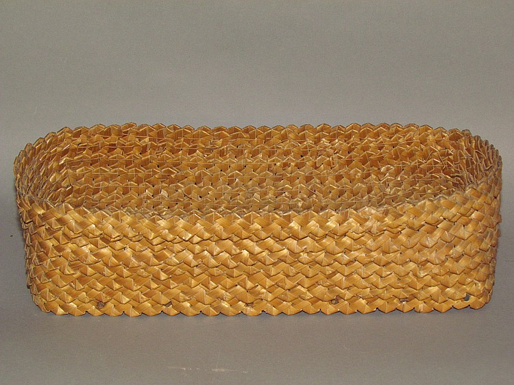 Plaited straw basket