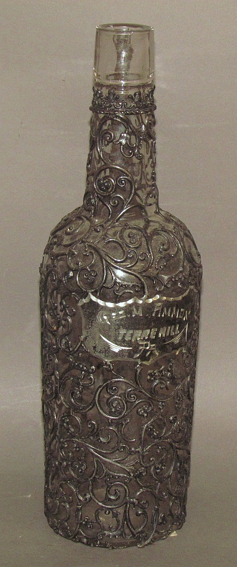 Unusual metal-clad back bar whiskey bottle