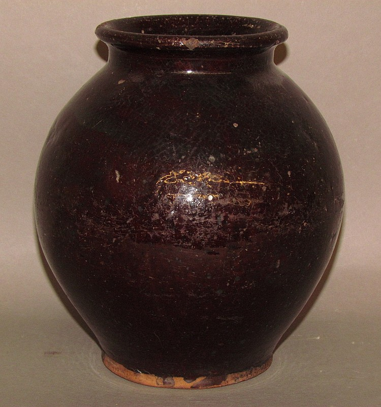 Ovoid Redware crock with manganese glaze
