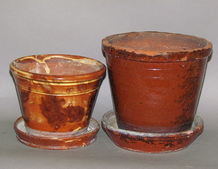 2 redware flower pots with saucers