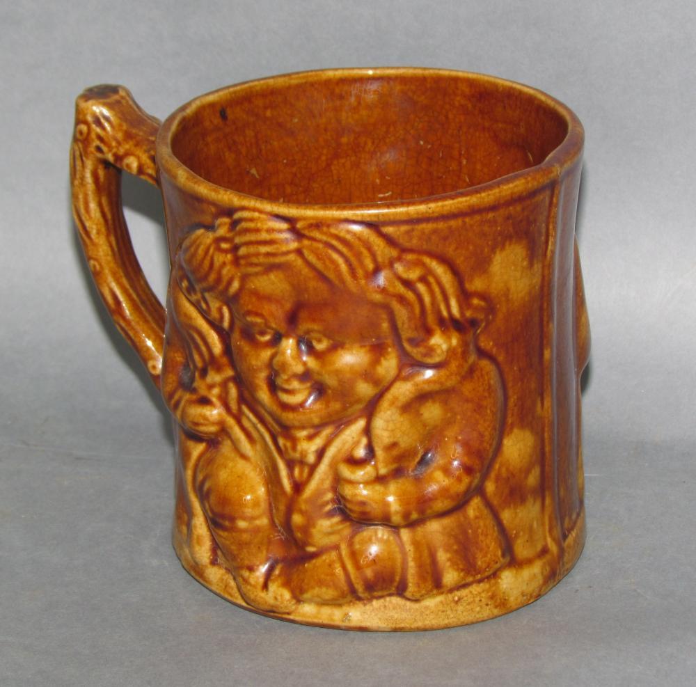 Molded yellowware Rockingham glazed mug