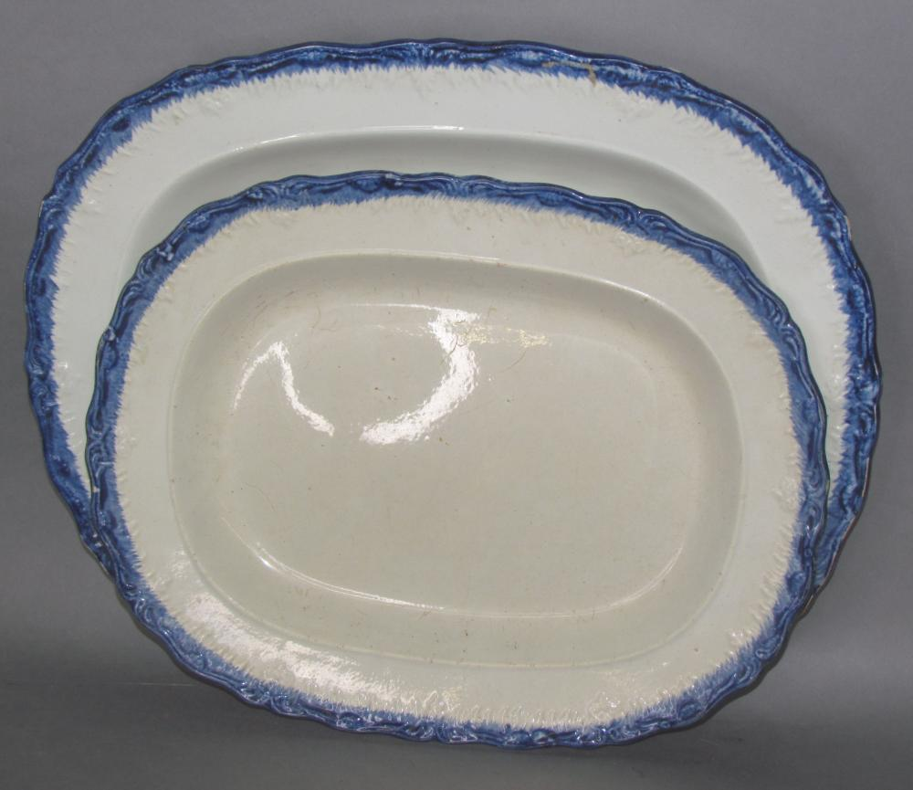 2 blue shell edged platters
