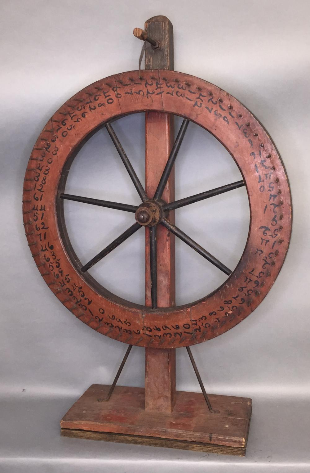 Early red painted game wheel