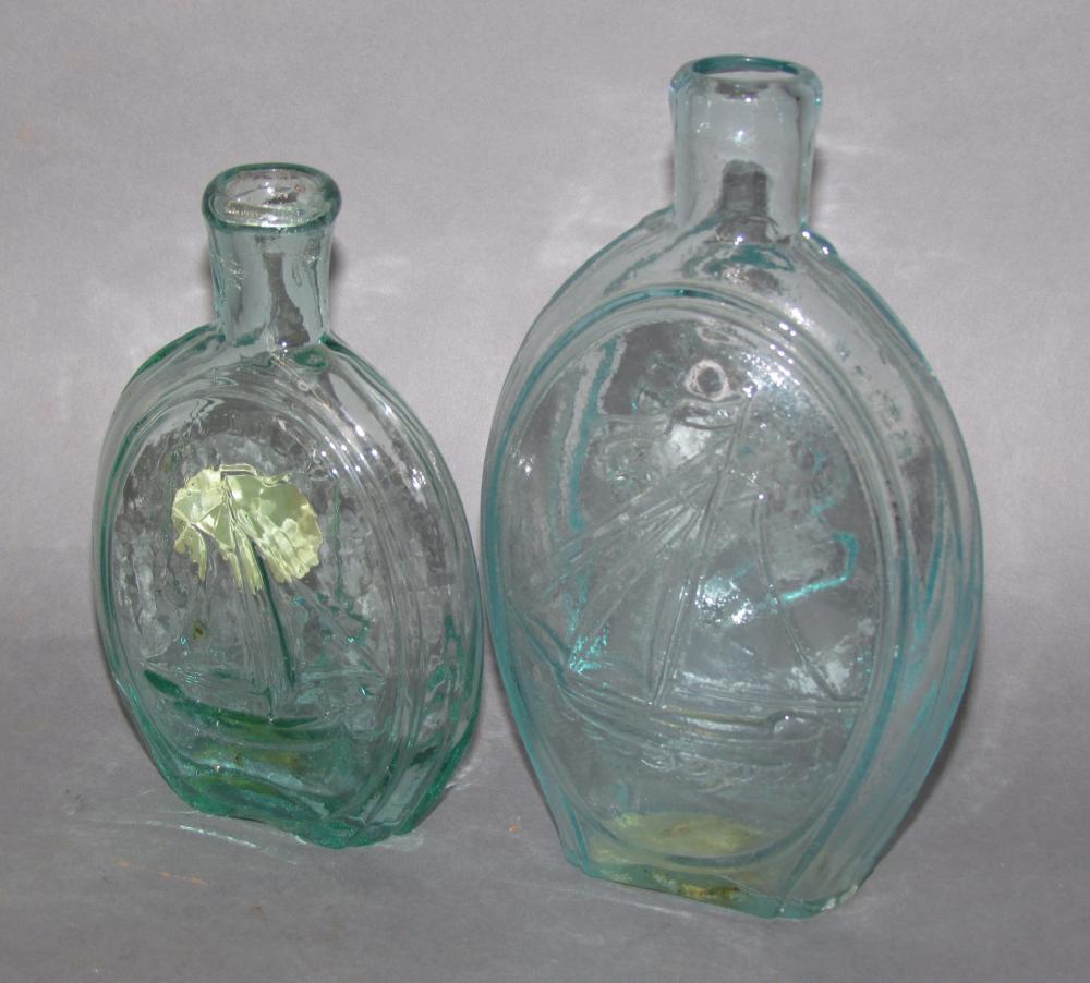 2 molded glass flasks