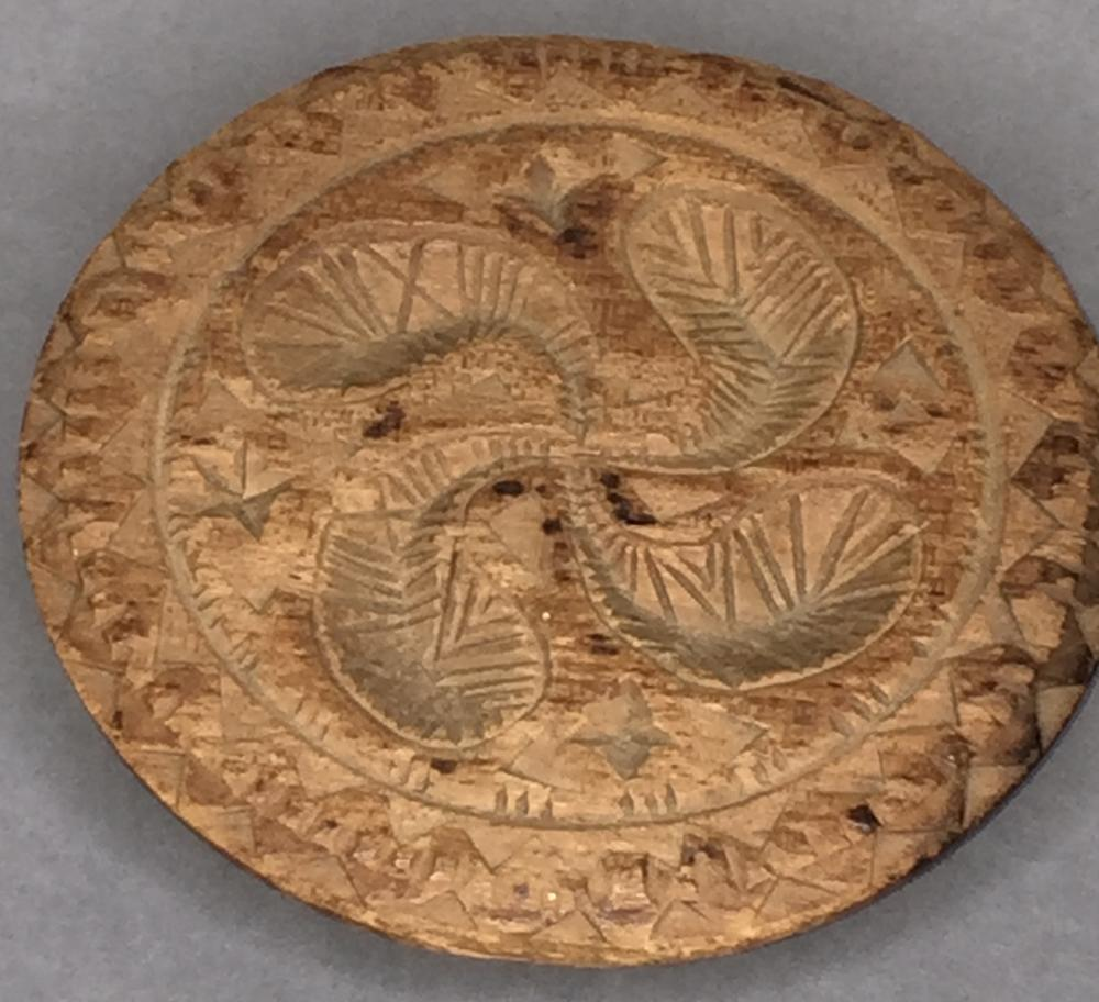 Early carved pine pinwheel design butter print