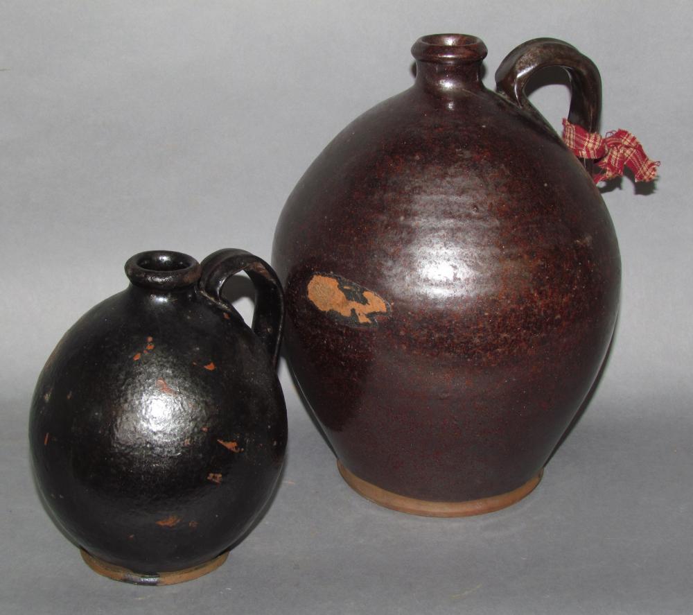 2 PA ovoid redware jugs