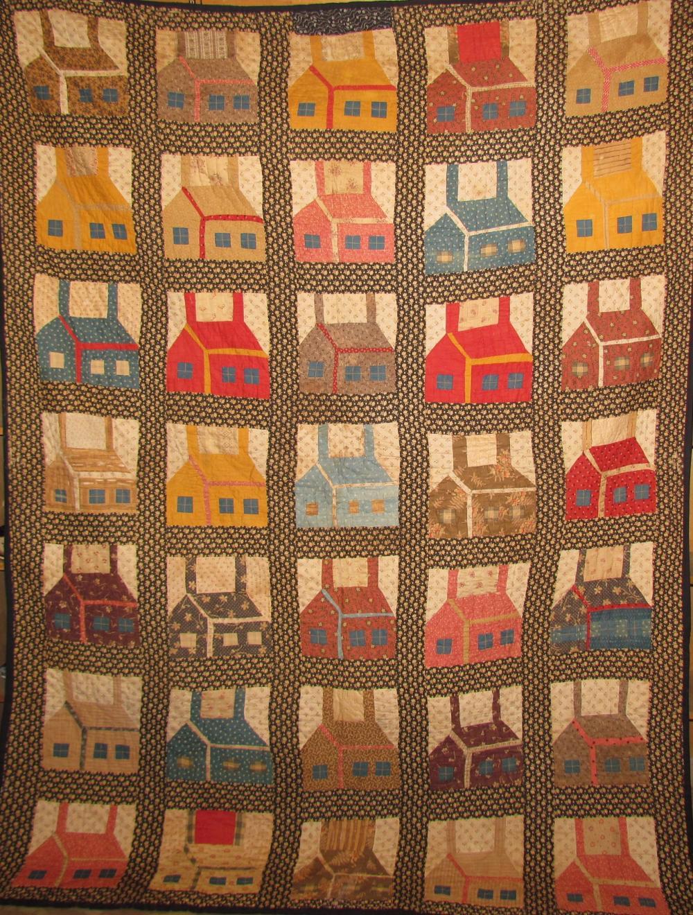 """Colorful """"Schoolhouse"""" patch design quilt"""
