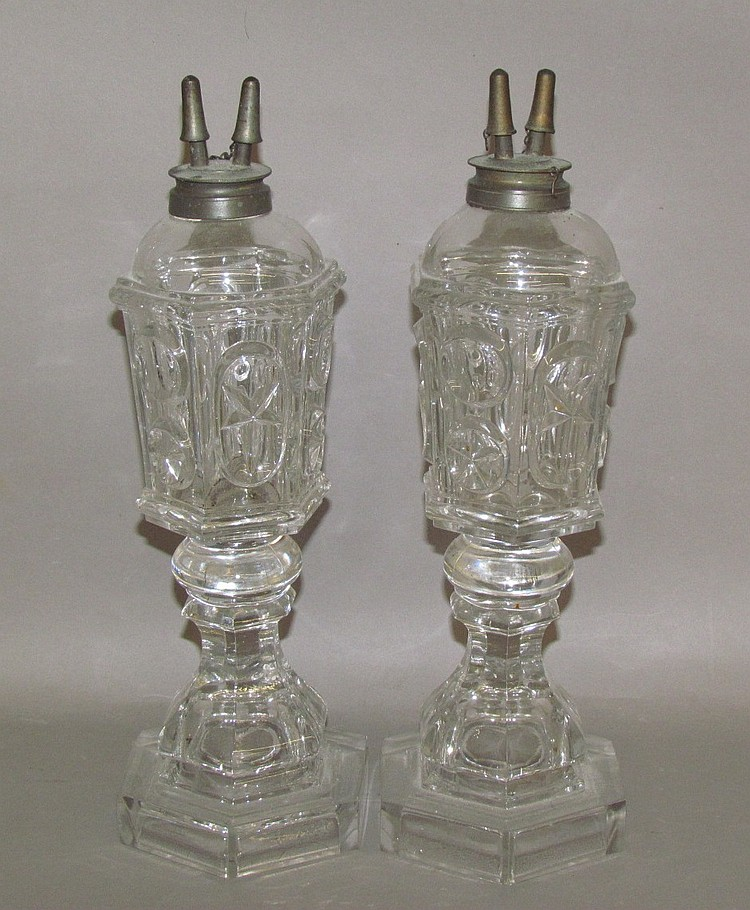 Pair of uncolored sandwich glass pressed star & punty fluid lamps