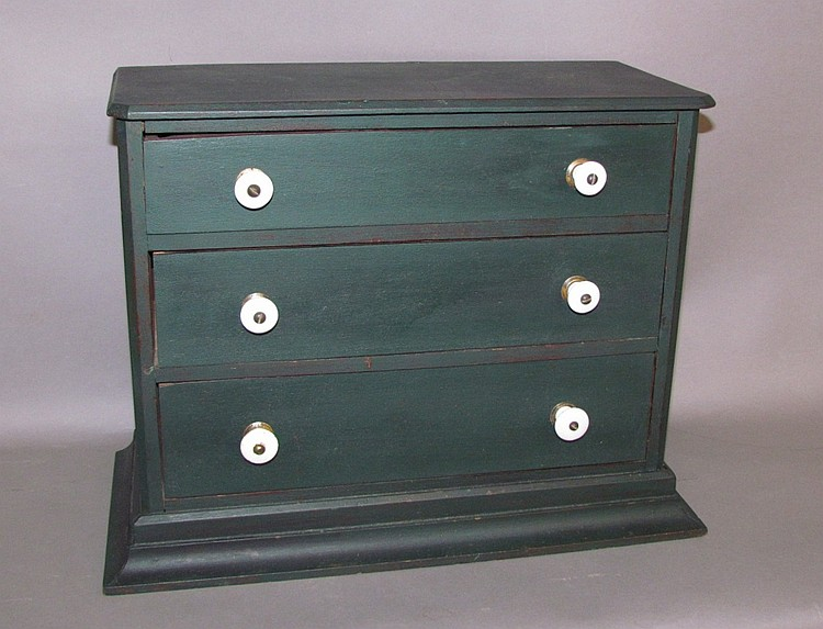 Green painted softwood three drawer seed chest