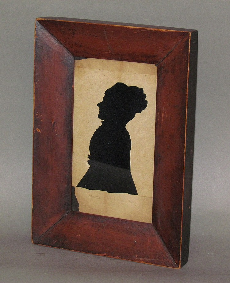 Framed scissors work sillhouette of a young woman