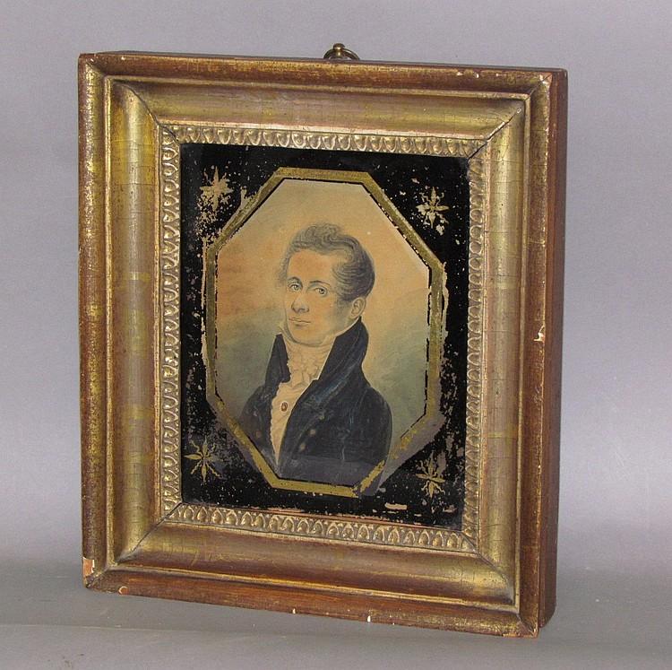 Framed watercolor portrait of a young gentleman in regency attire