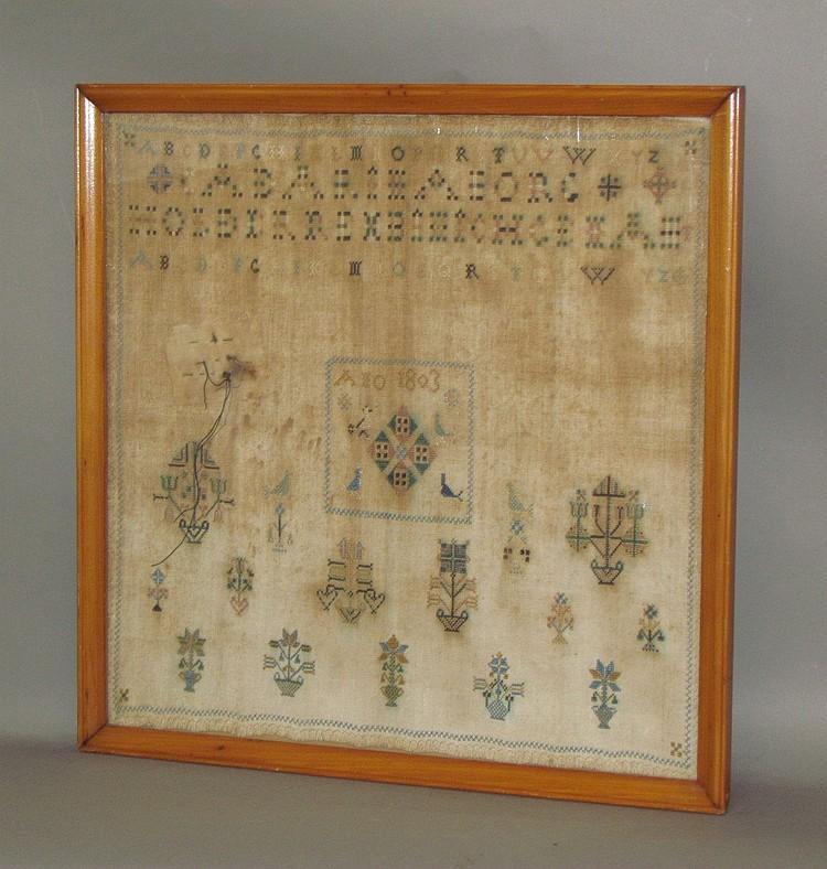 Early framed embroidered sampler