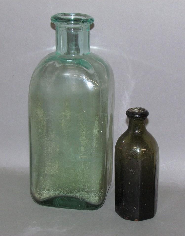 2 blown in a mold glass bottles