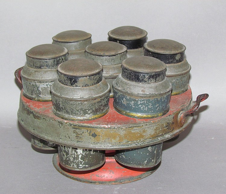 7 cannister revolving tin spice rack