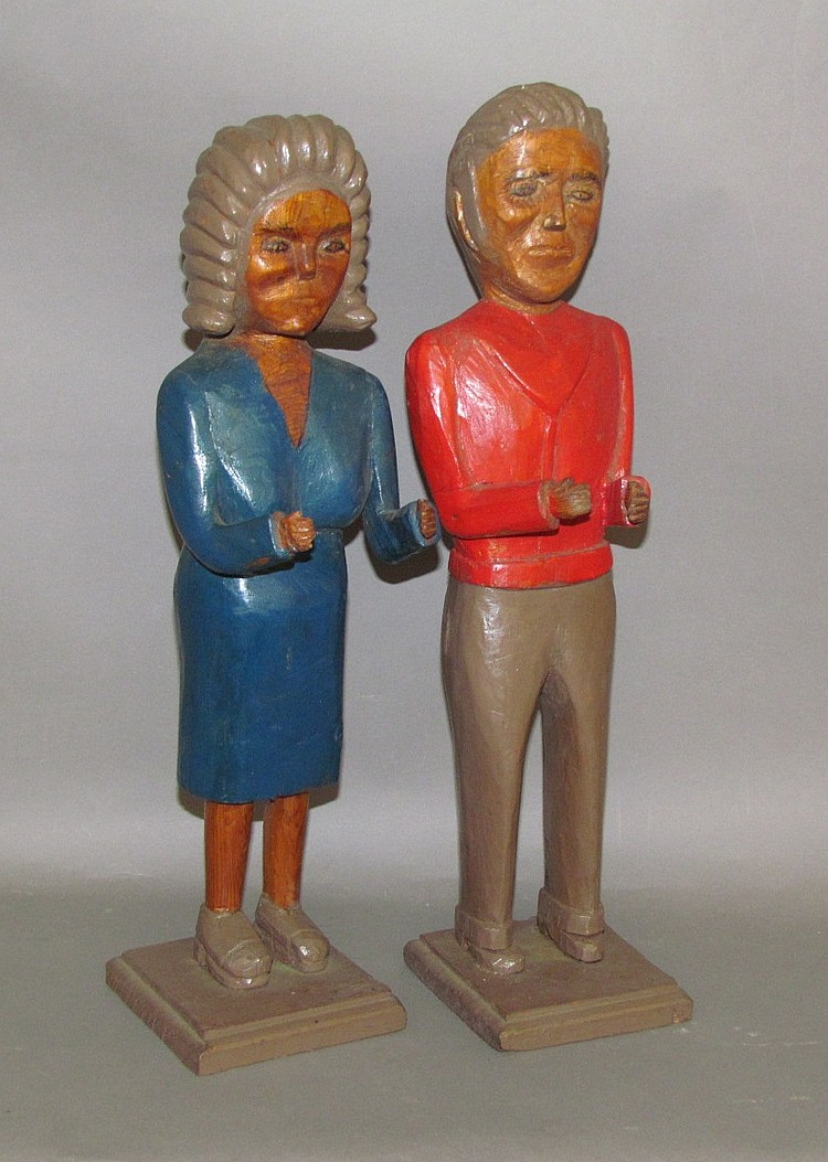 Pair of folk art characature carvings