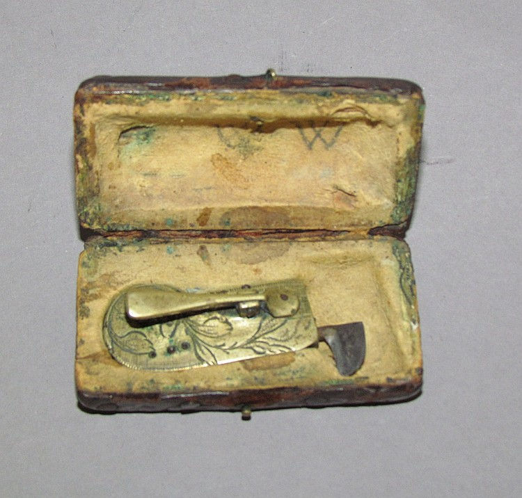 Brass spring loaded fleam in leather box
