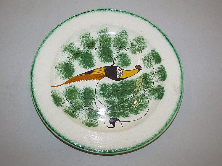 English creamware green shell edged plate with a peafowl among sponged foliage