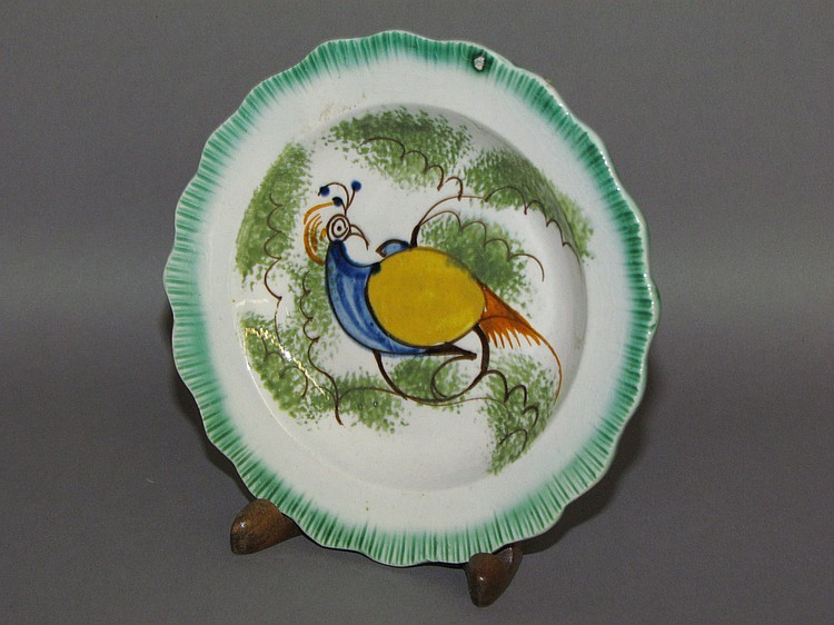 English creamware green shell edged cup plate with a peafowl within green sponged foliage