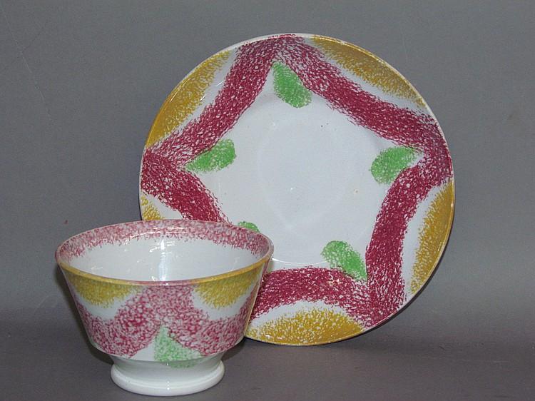 Scarce English earthenware rainbow spatter handleless cup & saucer
