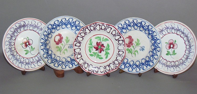 Group of 5 English earthenware stick spatter toddy plates