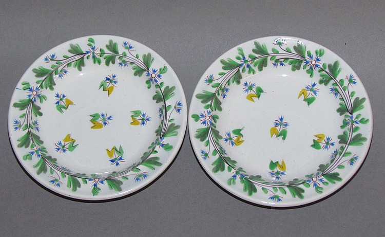 Pair of English pearlware child's toy dishes with polychromal floral design