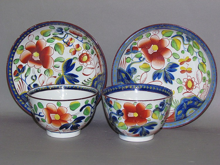 Pair of English pearlware Gaudy Dutch single rose handleless cups and saucers