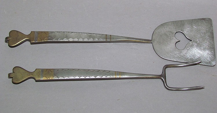 2 matched Tom Loose brass accented utensils