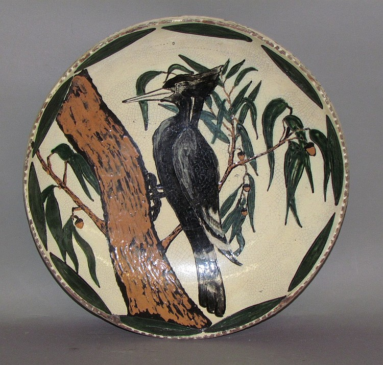 Large redware bowl with woodpecker by Mary Spellman Shooner