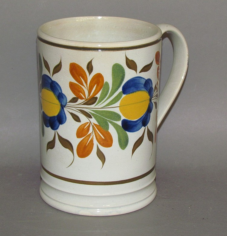 Large English pearlware floral decorated tankard