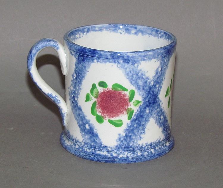 Scarce blue spatter mug