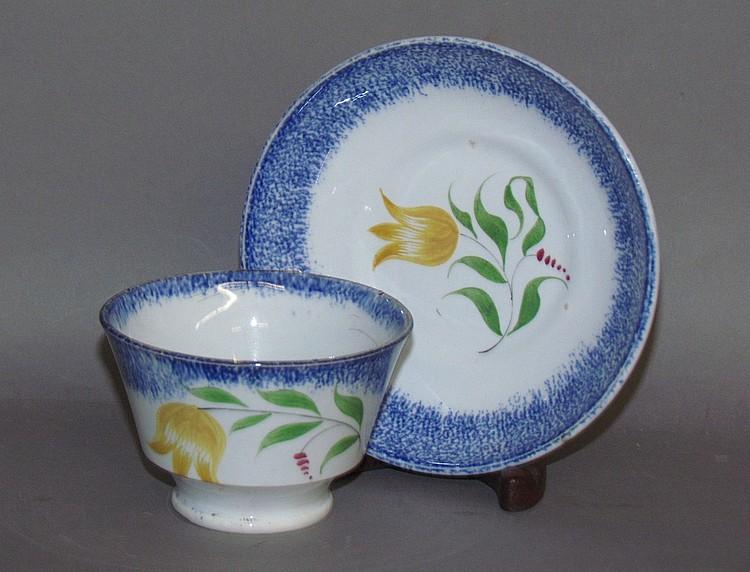 Blue spatter child's handleless cup & saucer