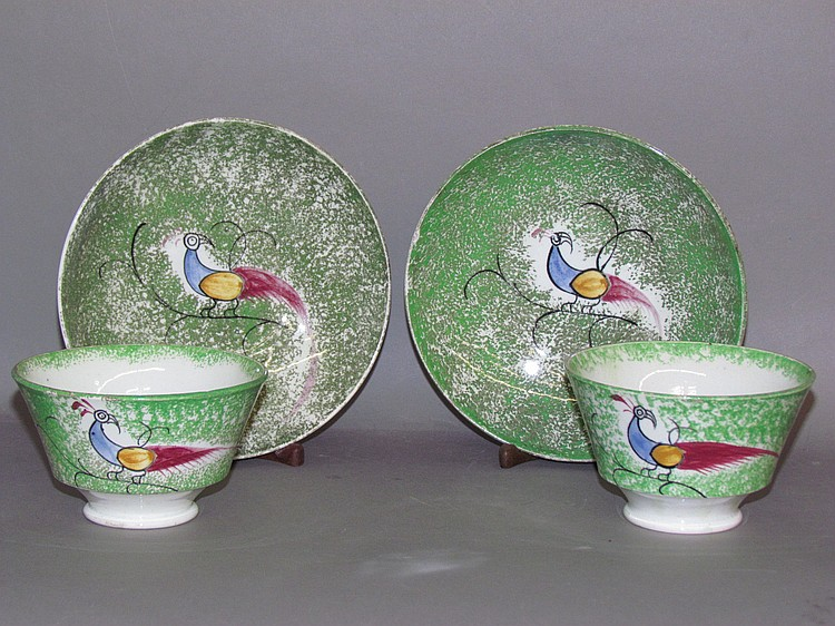 Pair of green spatter cups & saucers