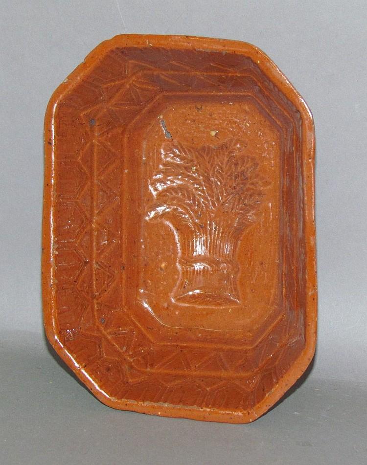 PA redware sheaf of grain octagonal food mold