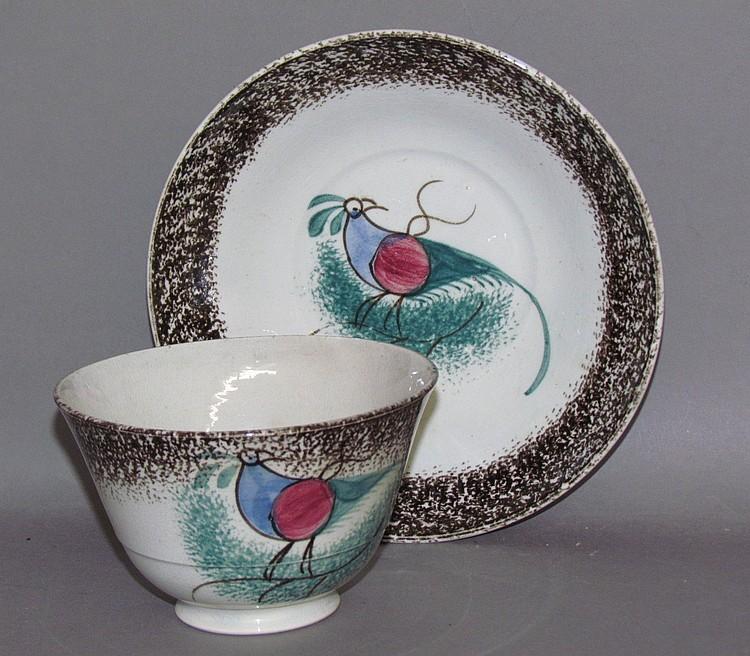 Dark brown spatter rim peafowl cup & saucer