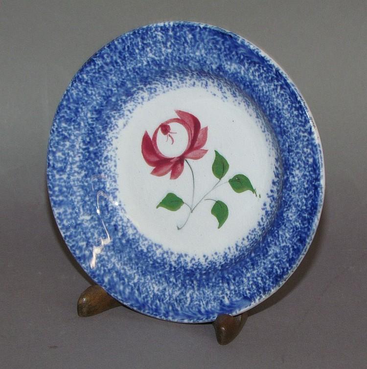 Blue spatter cup plate, rose motif