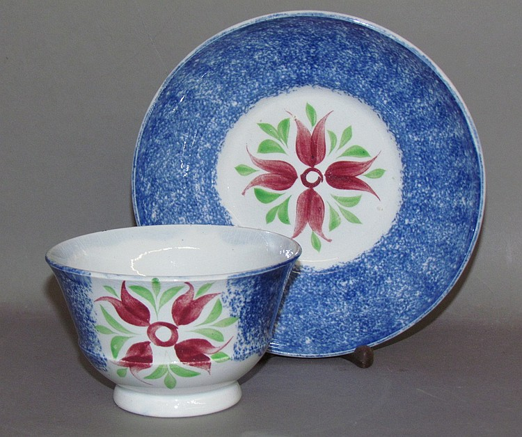 Blue spatter cup & saucer with cluster of 4 buds motif