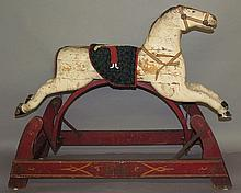 Wooden painted rocking horse