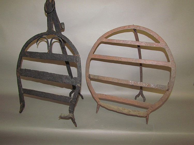 2 wrought iron plate warmers