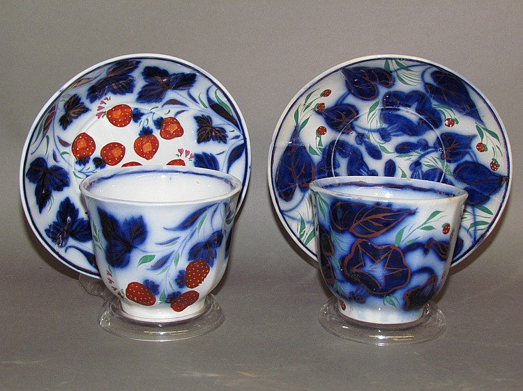 2 flow blue ironstone handleless cups & saucers