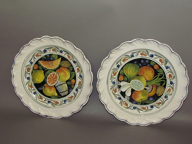 Pair of tin glazed earthenware plates