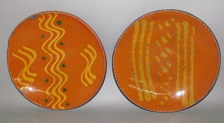 Lot 17: 2 Shooner reproduction slipware pie plates