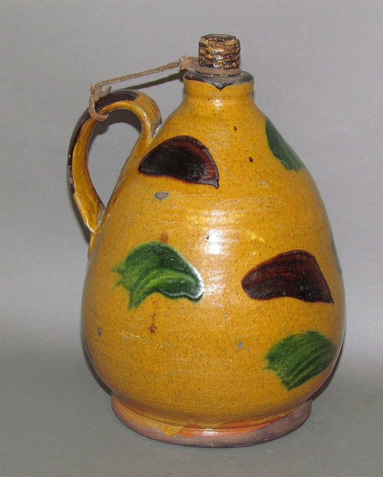 Shooner ovoid handled redware jug