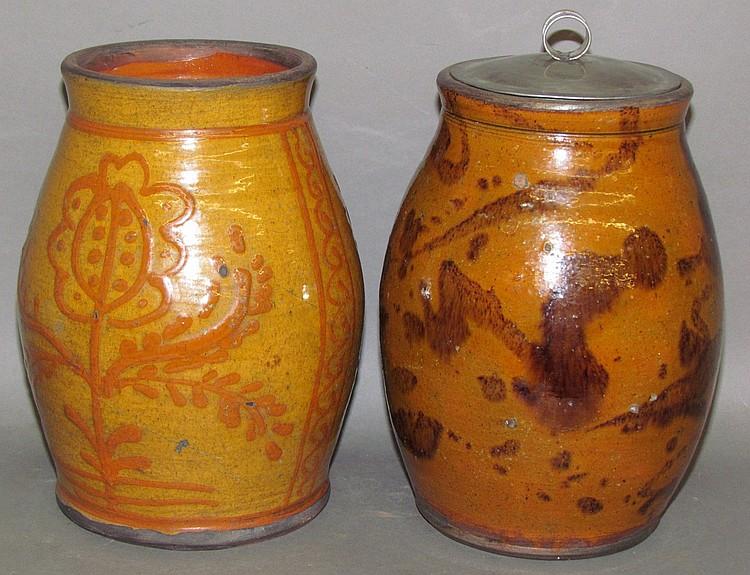 Lot 18: 2 Shooner redware tobacco jars