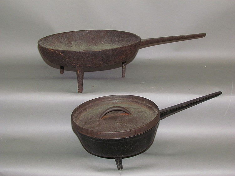 "Lot 49: 2 cast iron ""spider"" footed fry pans"