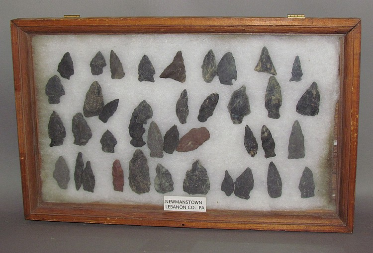 Display of 39 stone points