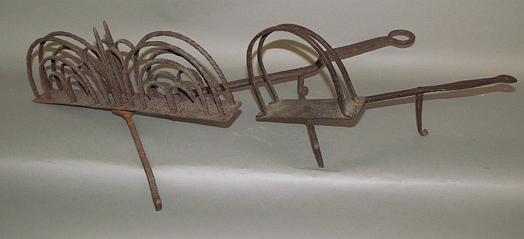 2 wrought iron kick toasters