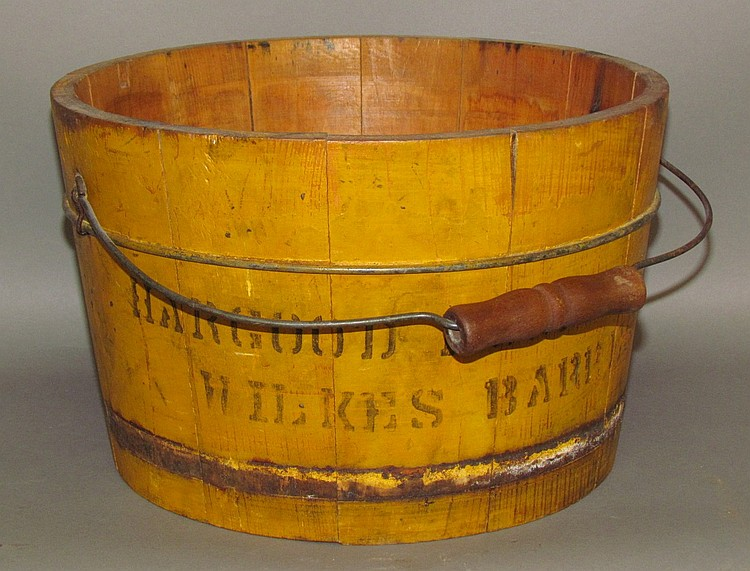 Yellow painted wooden bucket