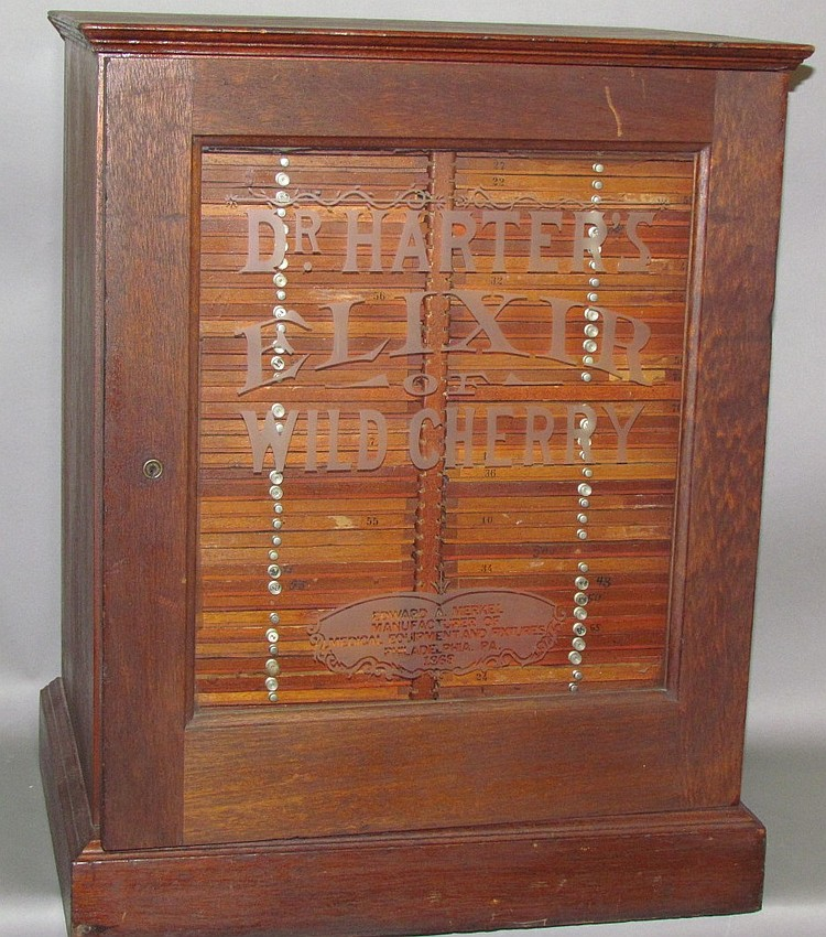 Mahogany Dr. Harters Elixir glass door display store cabinet