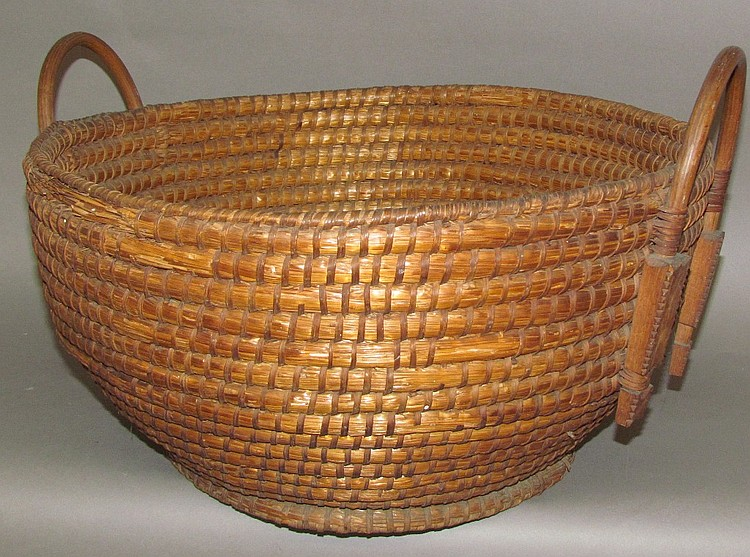 Rare large rye straw basket with chip-carved handles